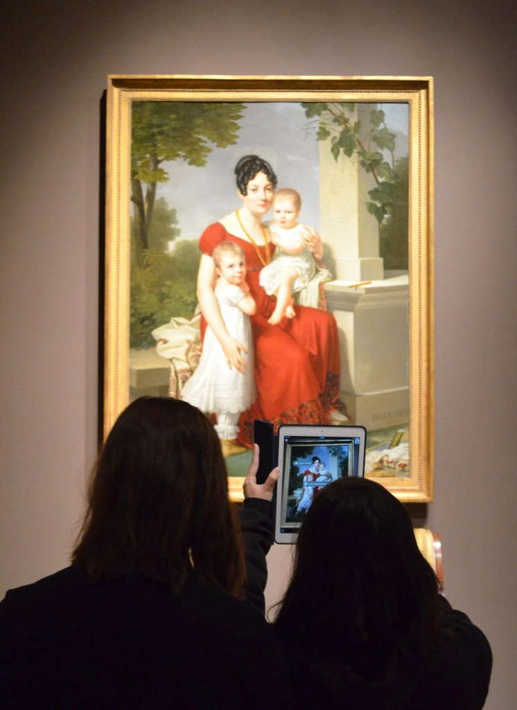 Figure 1: Teens testing augmented reality in SAM collection galleries. Mme. H and Her Children,1815. Louis André Gabriel Bouchet. Oil on canvas, 65 1/8 x 48 1/4 in.Seattle Art Museum, Eugene Fuller Memorial Collection, 62.75. Photo: Brenna Darroch.