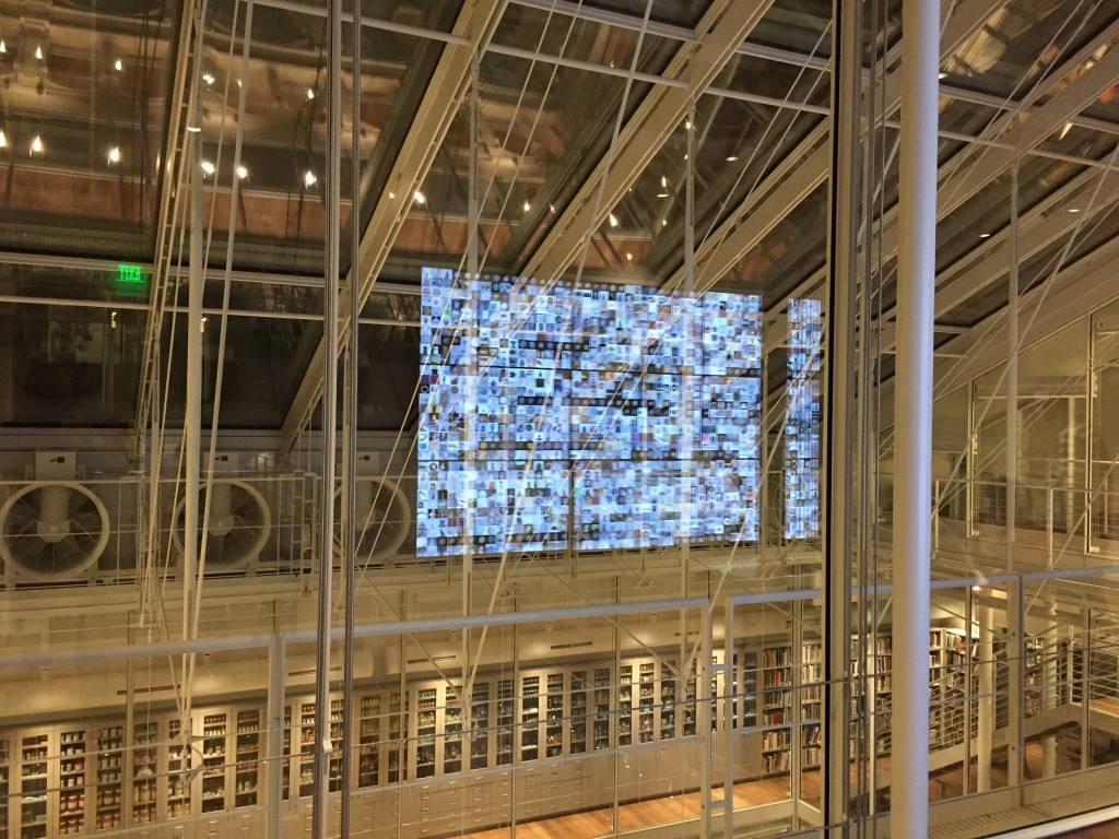Figure 17 – The holographic effect of the video wall reflected in the glass walls of the Lightbox Gallery