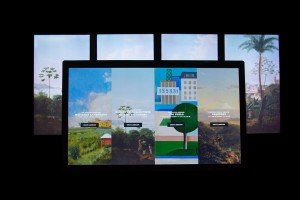 A multitouch wall displays the starting screen for the interactive, Landscapes Carry Meaning.