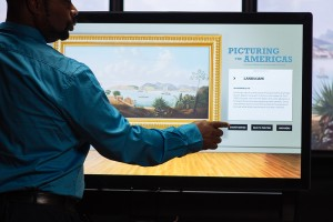 A user engages with the multitouch wall interactive, Landscapes Carry Meaning.