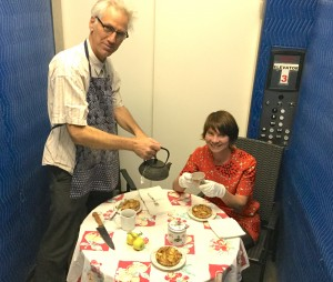 David Costanza and Liz Neely have tea in the Harwood Museum's freight elevator promoting Art+Tea
