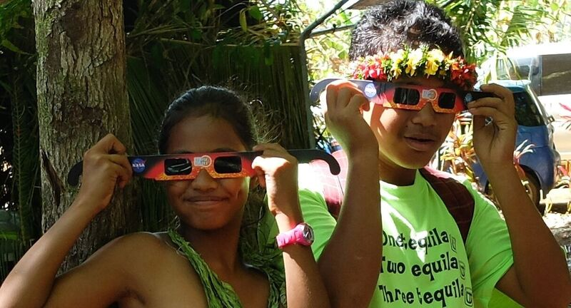 Kids on Yap island with their eclipse viewing glasses